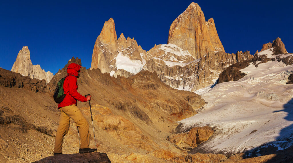 Hiker admiring the Mount Fitz Roy and Cerro Torre Mountains