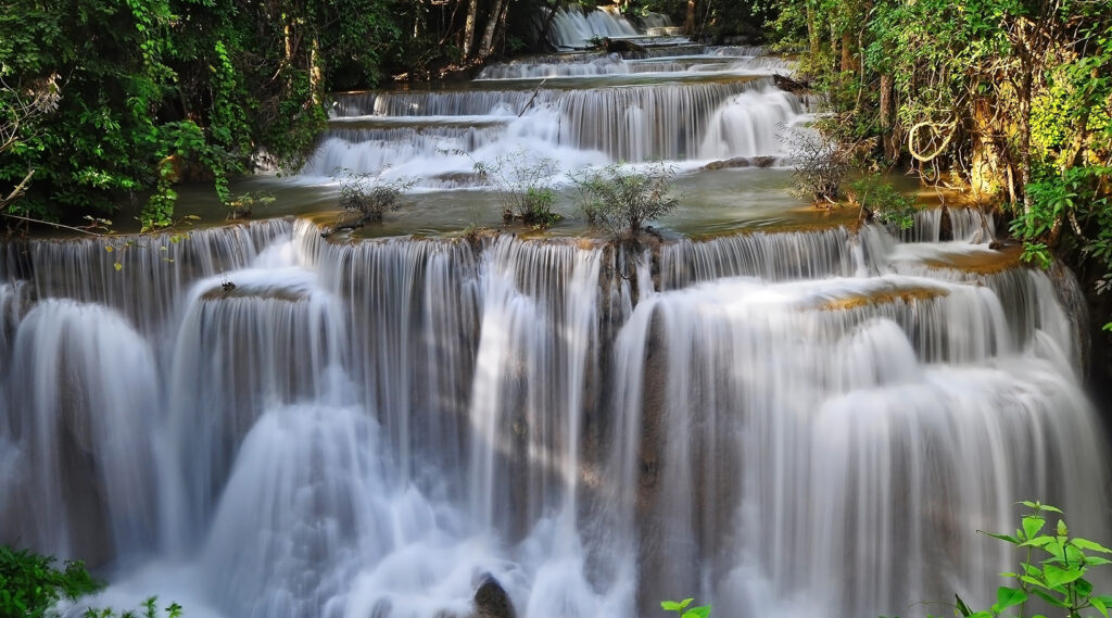 Succession of stunts in Huay Mae Khamin Waterfall staircase