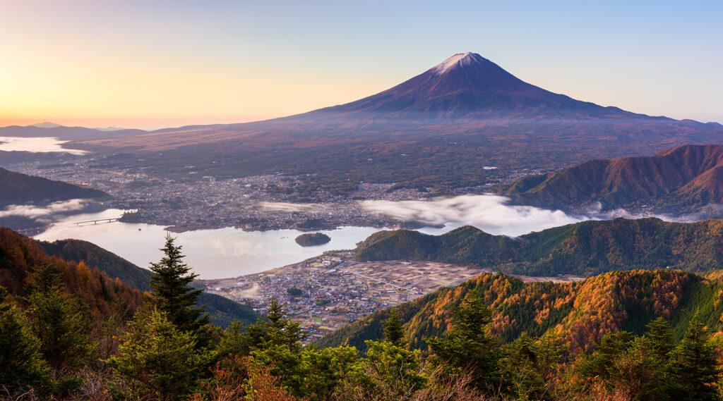 Conical silhouette of Mount Fuji culminating above Lake Kawaguchi