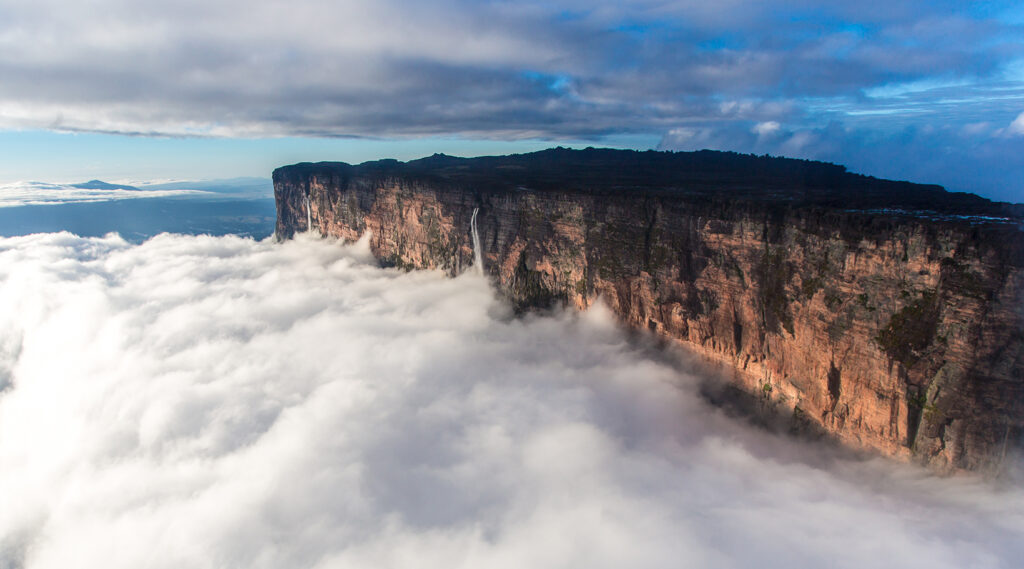 The high plateau of Mount Roraima rising above the clouds