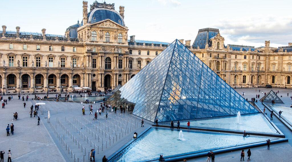 Close view of the glass pyramid of Louvre Museum