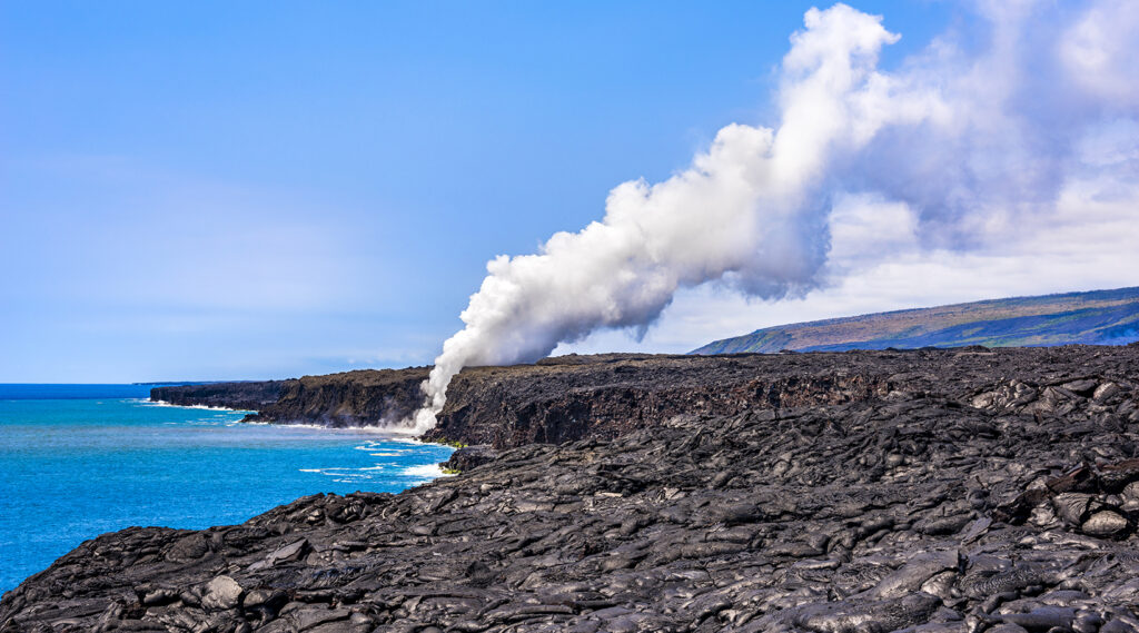 Smoke from the lava of the Kīlauea volcano spilling into the Pacific Ocean
