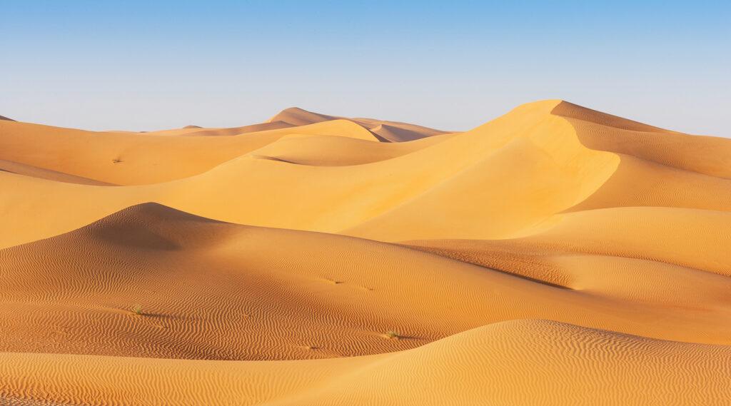 Superposition of orange sand dunes from the Rub' al Khali desert