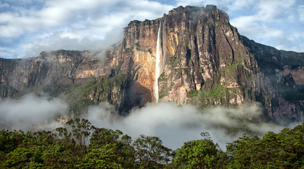Water vapour of the Angel Falls descending at the foot of the Auyán-tepui mountain